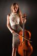 Elegant girl playing on cello