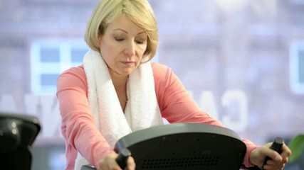 Mature woman exercising at the gym; HD 720, H 264