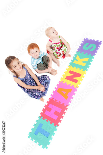 Three kids with thanks sign