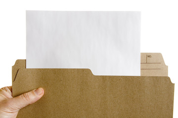 Hand holding file folder with blank sheet of paper