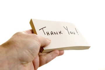 Hand giving a thank you note