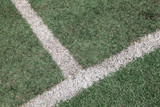 intersection of white line on soccer football field poster