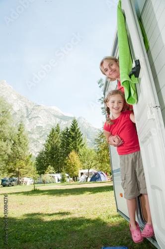 Leinwandbild Motiv Little girl with mother in camper