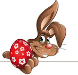 easter bunny showing red egg