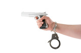 Hand with gun and handcuffs isolated on white