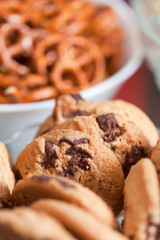 Cookies and pretzels in bowls, shallow DOF