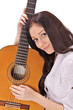 Young beautiful smiling brunette lady with acoustic guitar
