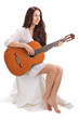 Young beautiful brunette lady playing acoustic guitar