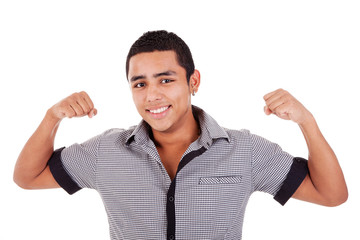 Portrait of a very happy  young latin man with his arms raised