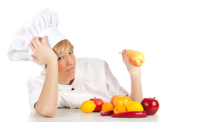 female cook in white uniform with fruits and vegetables