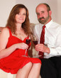 A Husband and Wife Toast with Red Wine on Valentine's Day
