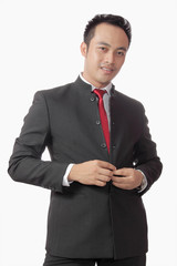 attractive asian man in suit over white background