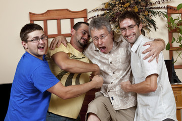 Horseplay Three young men beating up an older man