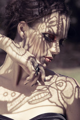 beautiful woman with lace shadows