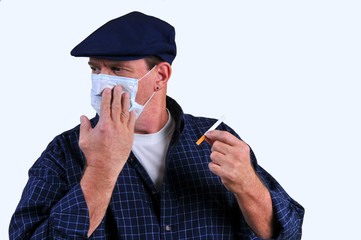 Man with breathing mask turning away from cigarette