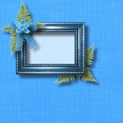 Wooden frame for photo with blue orchids and green fern