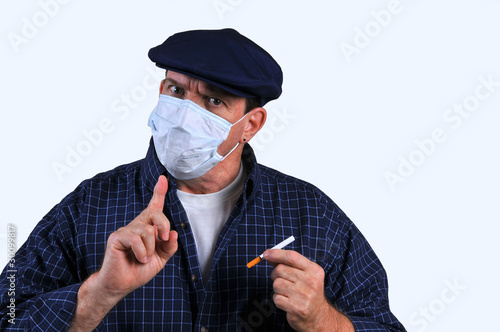 Man with breathing mask cautioning users of cigarettes