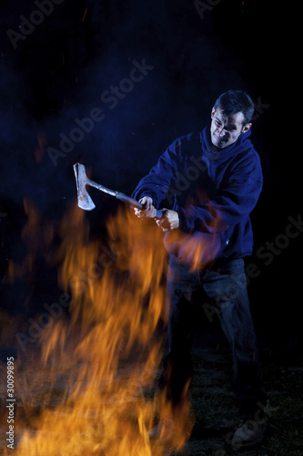 Axe wielding maniac by a fire