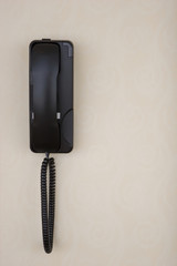 Wall mounted courtesy phone