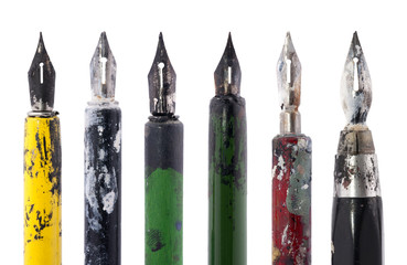 Collection of old colorful pens isolated on white