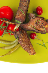 savory plate: grilled ribs over green