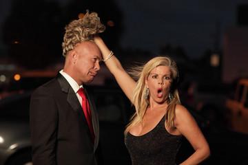 Woman revealing the bald man