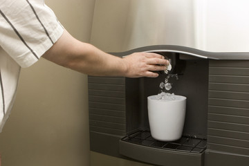 Man filling bucket from Ice machine