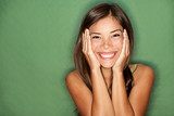 Surprised happy woman on green background - 30108216
