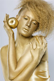 <b>golden girl</b> with apple - 160_F_30108883_k8qnfQo73E5vUgCJzfT3tDyKMBFp9OKk
