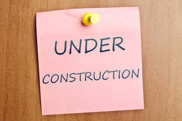 Under construction post it