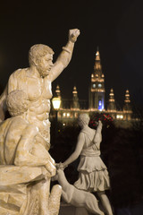 Vienna - mythology sculpture and parliament in the night