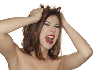 woman holding head with her hands screaming