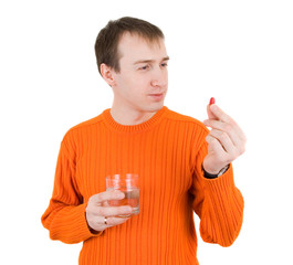 young man with pills in hand