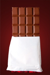 chocolate in bar with open white cover