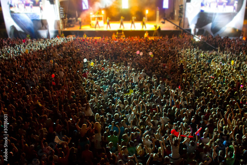 stage with giant crowd