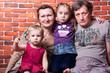 Happy seniors couple with grandchildren