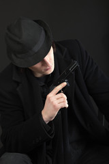 Man with gun and black hat