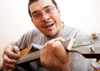 Funny man playing guitar