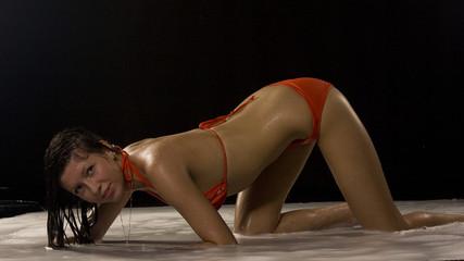 Wet Girl wearing red swimsuit
