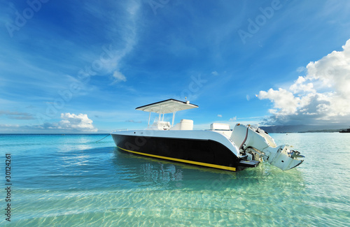 Beautiful beach with motor boat