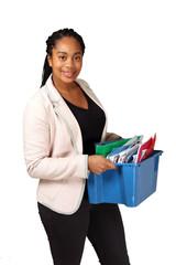 Smiling black female holding box of documents