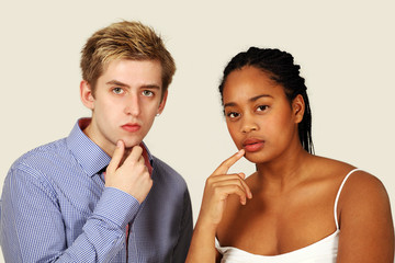 Serious thoughtful couple of mixed race