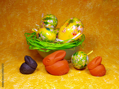 Easter decoration with eggs and ceramic bunnies