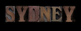 the word Sydney in old letterpress wood type