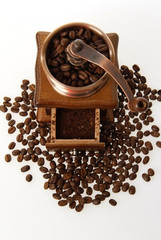 coffee mill with roasted beans from above