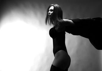 Sexy woman posing over dark background.