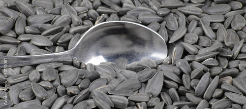 sunflower seeds background and teaspoon