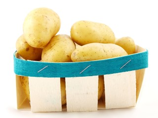Potatoes in a basket towards white