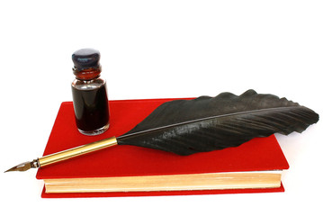 Red book, bottle of ink  and quill isolated on white