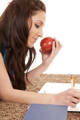 Woman on floor with apple writing
